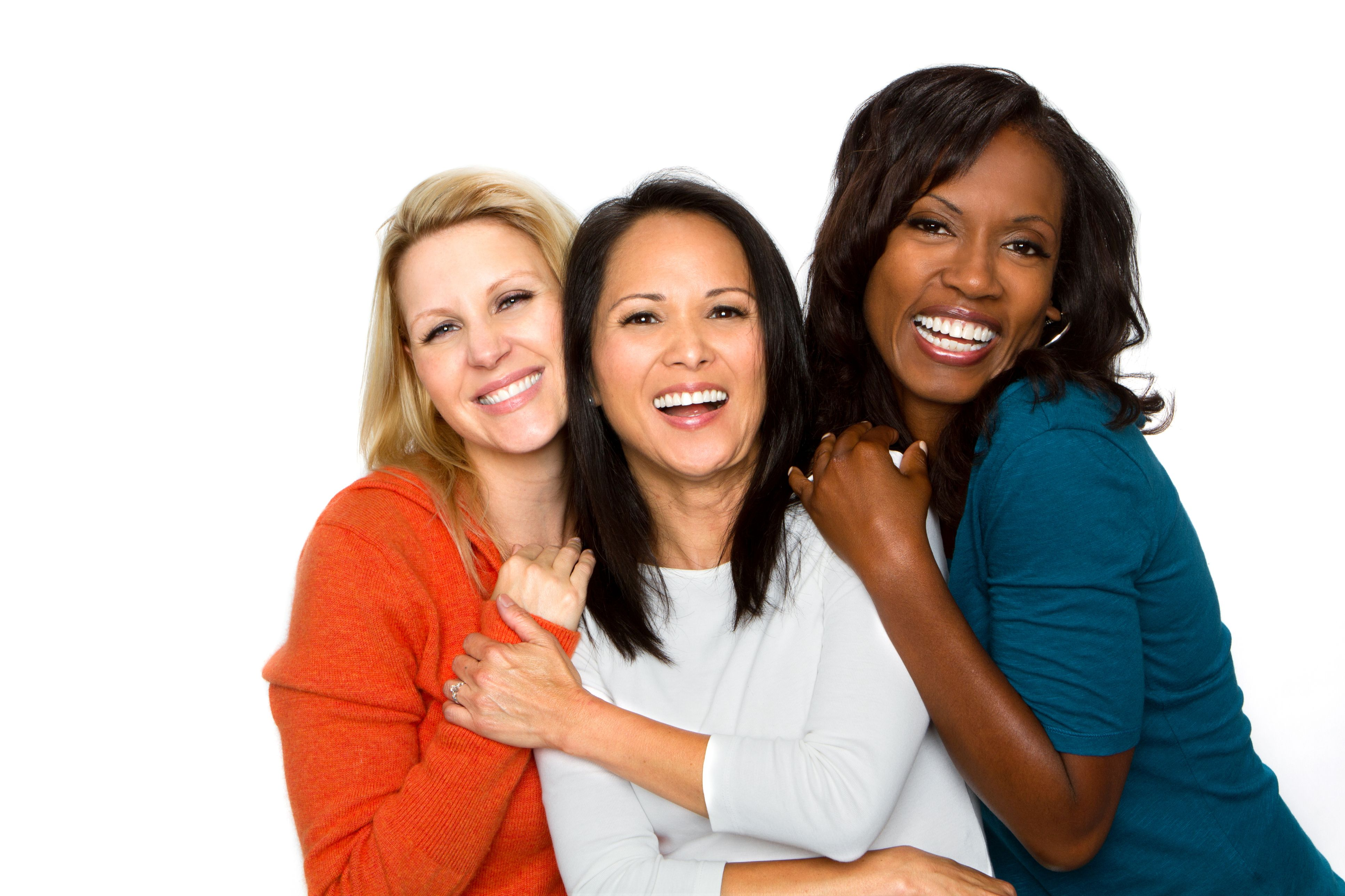 three female friends smiling