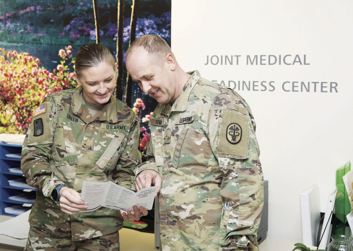 Maj. Kelly Green, Joint Medical Readiness Center department chief, left, and Maj. Duance Thomas, chied nurse officer in charge, at the center's reception area, Nov. 18.